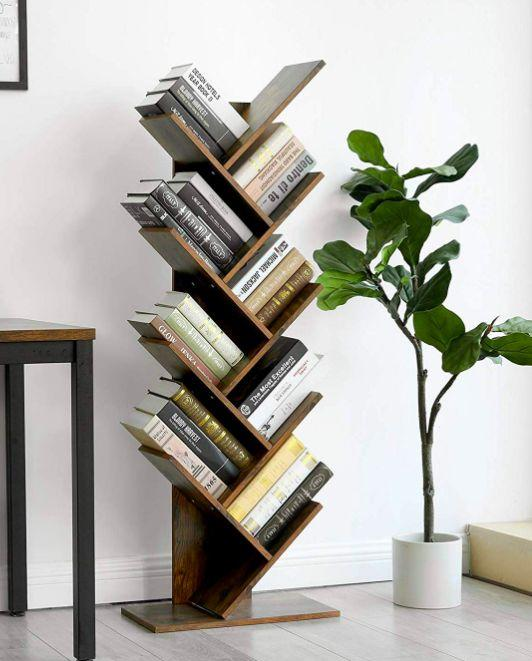 """This eye-catching take on traditional shelves will really spruce up your reading nook.<br /><br /><strong>Promising review:</strong>""""I love this bookshelf!<strong>It's a work of art!</strong>I have not yet fastened it to the wall as I hate to put more holes in the wall but may have to once I fill it up with more books. This is the cutest."""" —<a href=""""https://www.amazon.com/gp/customer-reviews/R2BRQHNAE4TI2M?&linkCode=ll2&tag=huffpost-bfsyndication-20&linkId=57802f0f964212f78354c1247759da59&language=en_US&ref_=as_li_ss_tl"""" target=""""_blank"""" rel=""""nofollow noopener noreferrer"""" data-skimlinks-tracking=""""5854435"""" data-vars-affiliate=""""Amazon"""" data-vars-href=""""https://www.amazon.com/gp/customer-reviews/R2BRQHNAE4TI2M?tag=bfmal-20&ascsubtag=5854435%2C6%2C37%2Cmobile_web%2C0%2C0%2C16331333"""" data-vars-keywords=""""cleaning,fast fashion"""" data-vars-link-id=""""16331333"""" data-vars-price="""""""" data-vars-product-id=""""20945947"""" data-vars-product-img="""""""" data-vars-product-title="""""""" data-vars-retailers=""""Amazon"""">Amazon Customer<br /><br /></a><strong>Get it from Amazon for<a href=""""https://www.amazon.com/VASAGLE-Bookshelf-Standing-Bookcase-ULBC11BX/dp/B07PKP7SY9?&linkCode=ll1&tag=huffpost-bfsyndication-20&linkId=f08ed4b8c28cb25a16fb936c2ff48b4f&language=en_US&ref_=as_li_ss_tl"""" target=""""_blank"""" rel=""""nofollow noopener noreferrer"""" data-skimlinks-tracking=""""5854435"""" data-vars-affiliate=""""Amazon"""" data-vars-asin=""""B07PKP7SY9"""" data-vars-href=""""https://www.amazon.com/dp/B07PKP7SY9?tag=bfmal-20&ascsubtag=5854435%2C6%2C37%2Cmobile_web%2C0%2C0%2C16325635"""" data-vars-keywords=""""cleaning,fast fashion"""" data-vars-link-id=""""16325635"""" data-vars-price="""""""" data-vars-product-id=""""18874181"""" data-vars-product-img=""""https://m.media-amazon.com/images/I/41hUsQ5c8nL.jpg"""" data-vars-product-title=""""VASAGLE Tree Bookshelf, 8-Tier Floor Standing Bookcase, with Wooden Shelves for Living Room, Home Office, Rustic Brown ULBC11BX"""" data-vars-retailers=""""Amazon"""">$63.99+</a>(available in three colors).</strong>"""