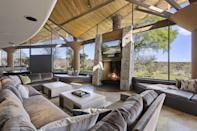 <p>Locally harvested wood and sprawling glass windows abound throughout the home.</p>