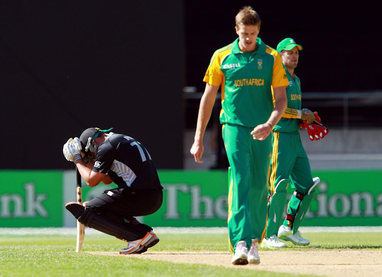 WELLINGTON, NEW ZEALAND - FEBRUARY 25:  Jesse Ryder of New Zealand recovers after being hit by a delivery from Morne Morkel of South Africa during the One Day International match between New Zealand and South Africa at Westpac Stadium on February 25, 2012 in Wellington, New Zealand.  (Photo by Hagen Hopkins/Getty Images)