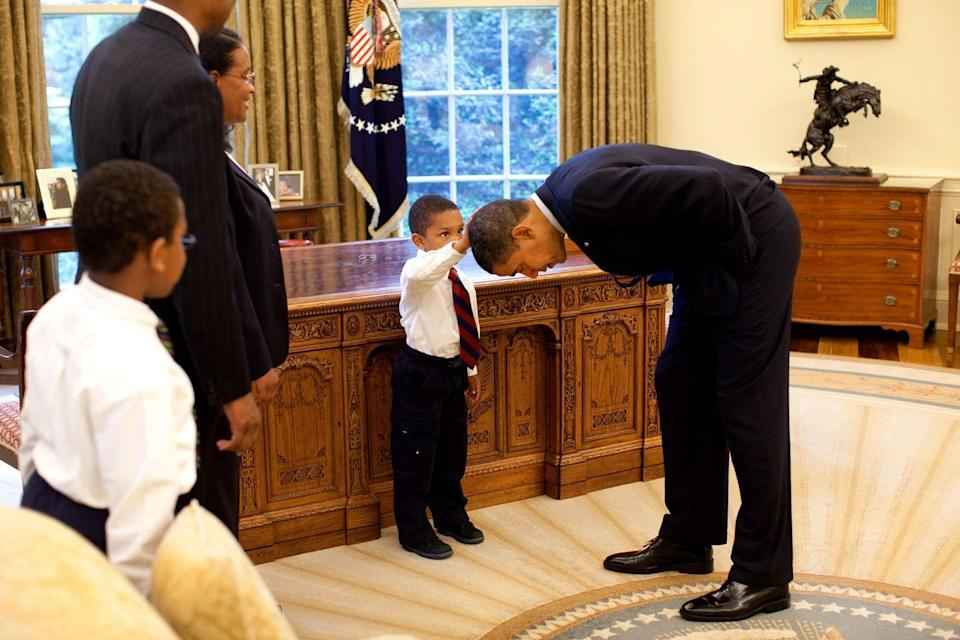 <p>2009. President Obama bends down to 5-year-old Jacob Philadelphia, who wanted to see if the President's hair felt like his own.</p>