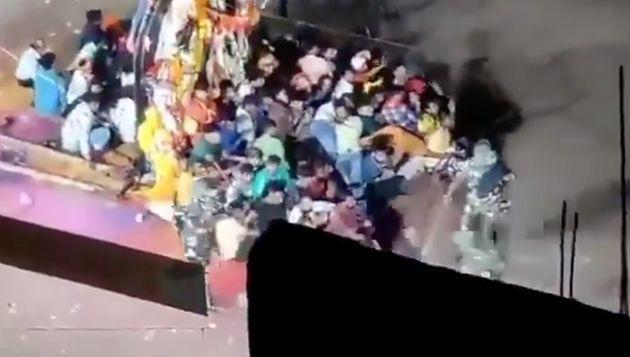 Screenshot from a video from the incident in Munger that shows police personnel attacking participants in a Durga Puja procession.