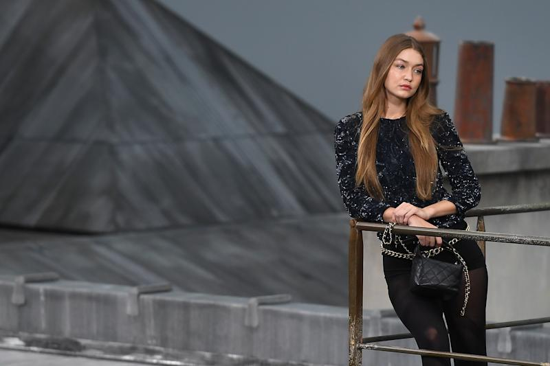 US - Palestinian model Gigi Hadid presents a creation by Chanel during the Women's Spring-Summer 2020 Ready-to-Wear collection fashion show at the Grand Palais in Paris, on October 1, 2019. (Photo by Christophe ARCHAMBAULT / AFP) (Photo credit should read CHRISTOPHE ARCHAMBAULT/AFP/Getty Images)