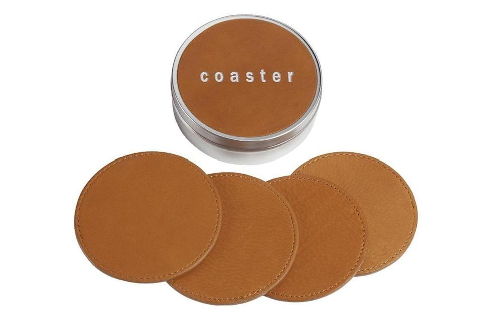 """<p>lucysmarket.com</p><p><strong>$35.00</strong></p><p><a href=""""https://lucysmarket.com/products/leather-coaster-set"""" rel=""""nofollow noopener"""" target=""""_blank"""" data-ylk=""""slk:Shop Now"""" class=""""link rapid-noclick-resp"""">Shop Now</a></p><p>Cover coffee rings with this chic leather coaster set. He'll actually use them when his friends come over. </p>"""