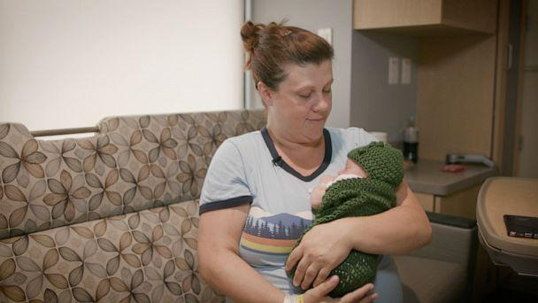 PHOTO: Hilary Costello holds her newborn baby, Emmett Costello, who is dressed in a knitted pickle costume at UPMC Magee Women's Hospital. (UPMC Magee Women's Hospital)