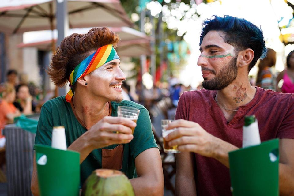 Men drinking at outdoor bar or party