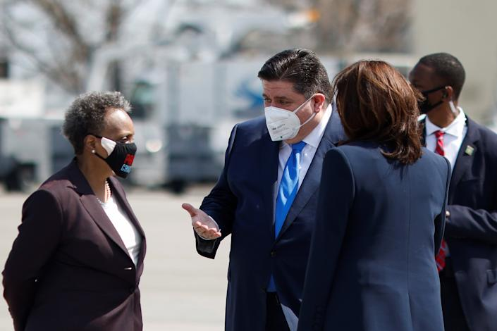 U.S. Vice President Kamala Harris meet Illinois' Governor J.B. Pritzker and Chicago's Mayor Lori Lightfoot after arriving at Chicago Midway International Airport in Chicago, Illinois, U.S., April 6, 2021. REUTERS/Carlos Barria
