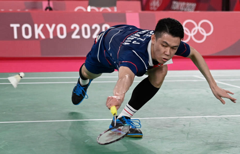 Malaysia's Lee Zii Jia hits a shot to China's Chen Long in their men's singles badminton round of 16 match during the Tokyo 2020 Olympic Games at the Musashino Forest Sports Plaza in Tokyo July 29, 2021. — AFP pic
