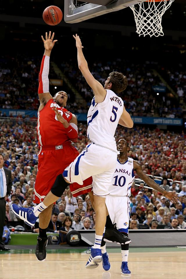 NEW ORLEANS, LA - MARCH 31:  Jared Sullinger #0 of the Ohio State Buckeyes shoots over Jeff Withey #5 of the Kansas Jayhawks in the first half during the National Semifinal game of the 2012 NCAA Division I Men's Basketball Championship at the Mercedes-Benz Superdome on March 31, 2012 in New Orleans, Louisiana.  (Photo by Jeff Gross/Getty Images)