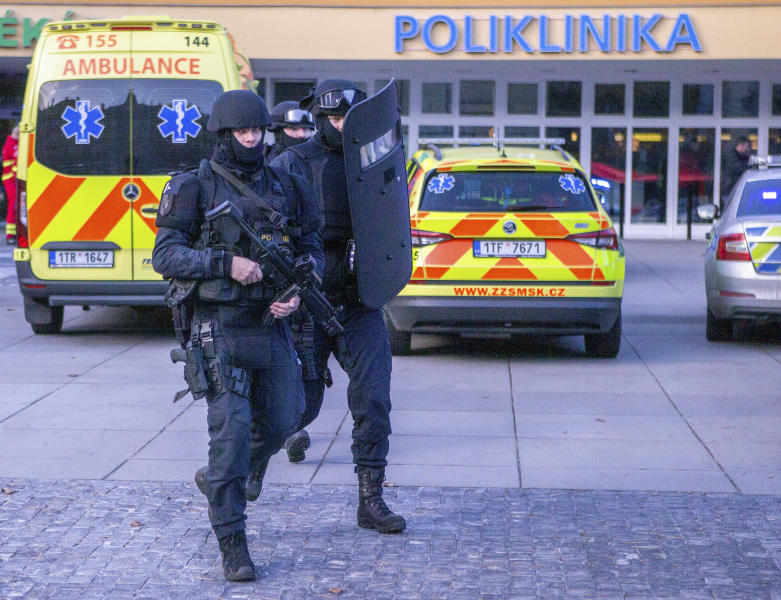 Police personnel outside the Ostrava Teaching Hospital after a shooting incident in Ostrava, Czech Republic, Tuesday, Dec. 10, 2019. Police and officials say six people have been killed and two people injured in a shooting in a hospital in the eastern Czech Republic. (Vladimir Prycek/CTK via AP)