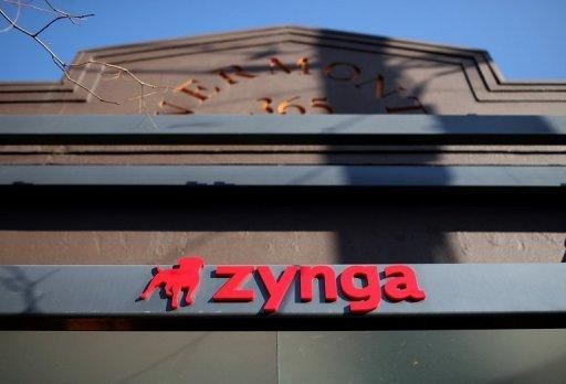 Zynga shares climb as game maker cuts losses