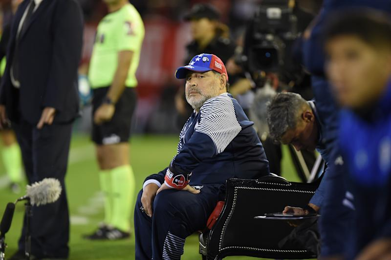 Diego Maradona managed Tuesday's Gimnasia game vs. Newell's Old Boys from an armchair. (Getty)