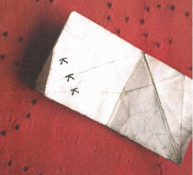 """A photo of """"KKK origami"""" allegedly given to a black student at a Texas school."""