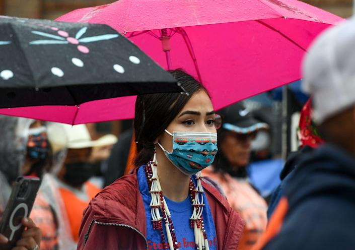 Little Wound High School student Kansas Clifford, 18, participates in a demonstration through the streets of Pierre after the final draft of the state's proposed social studies standards left out multiple specific references to the Oceti Sakowin on Monday, September 13, 2021.