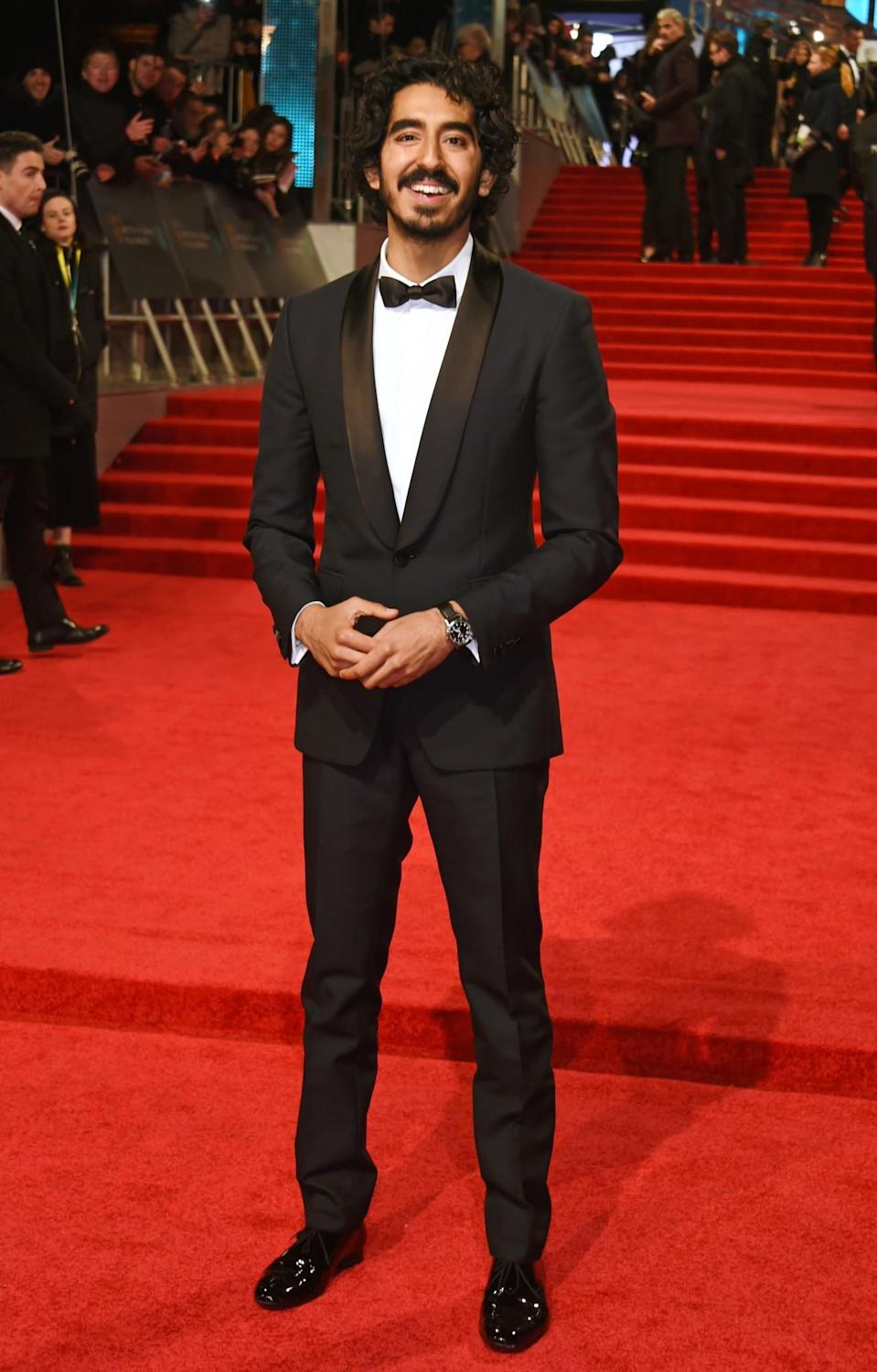 <p>The 'Lion' star suited up for the occasion – and looked every inch the British rising star. <i>[Photo: Getty]</i> </p>