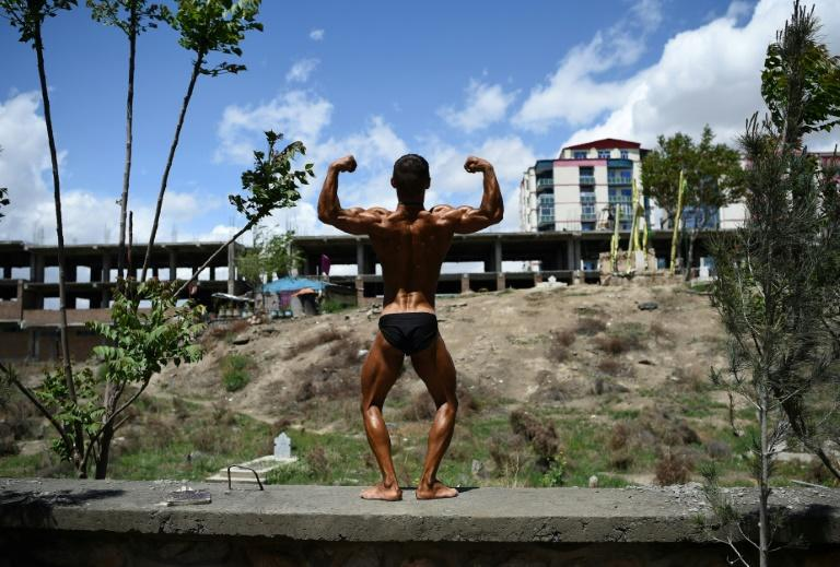 An Afghan bodybuilder poses after competing in a contest in Kabul, where the sport has become ubiquitous since the fall of the Taliban regime