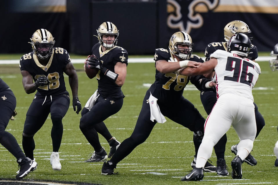 New Orleans Saints quarterback Taysom Hill (7) drops back to pass in the first half of an NFL football game against the Atlanta Falcons in New Orleans, Sunday, Nov. 22, 2020. (AP Photo/Butch Dill)
