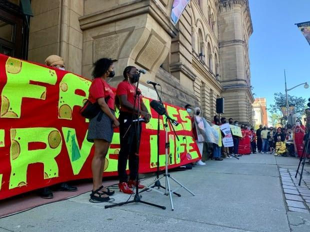 A rally held Saturday in Ottawa featured the families of 10 people who either died or were injured during encounters withpolice. (Natalia Goodwin/CBC  - image credit)