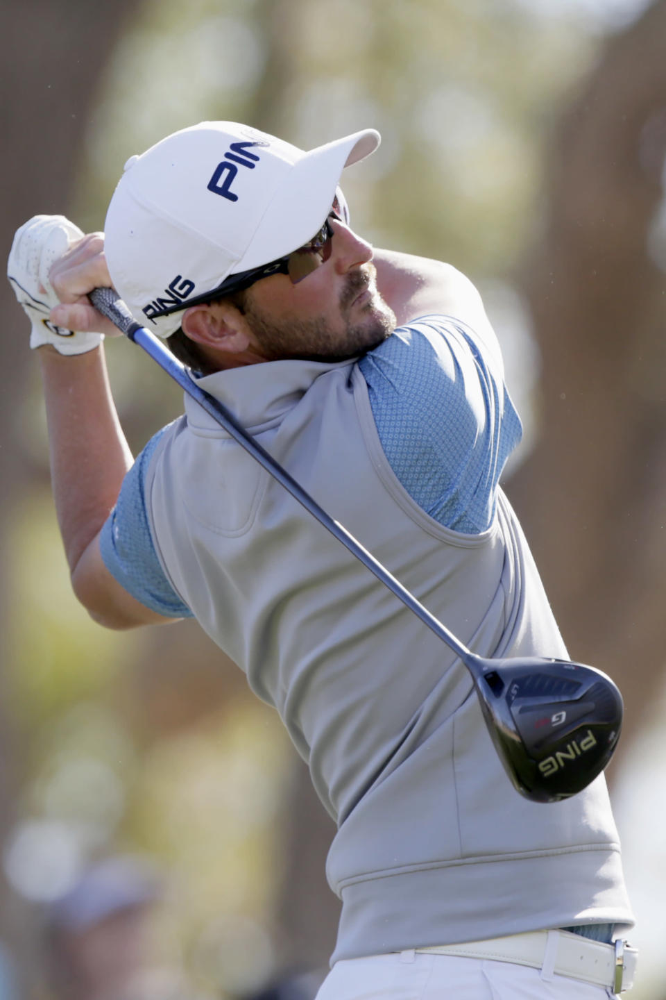 Andrew Landry follows through on the third tee during the final round of The American Express golf tournament on the Stadium Course at PGA West in La Quinta, Calif., Sunday, Jan. 19, 2020. (AP Photo/Alex Gallardo)