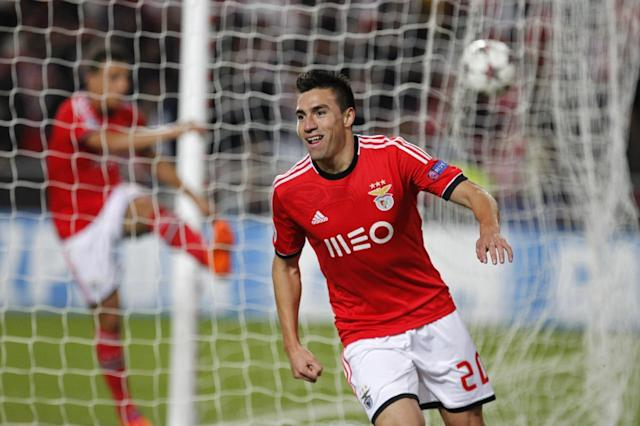 Benfica's Nico Gaitan celebrates after scoring his side's first goal during a Group C Champions League soccer match between Benfica and PSG at the Luz stadium in Lisbon, Tuesday Dec. 10, 2013. (AP Photo/Francisco Seco)