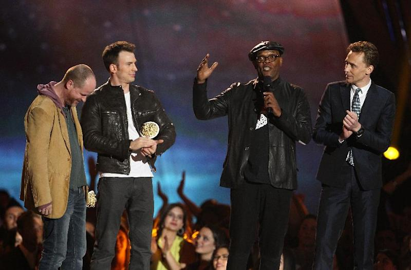 """Joss Whedon, Chris Evans, Samuel L. Jackson and Tom Hiddleston, from left, accept the award for best fight for """"Marvel's The Avengers"""" at the MTV Movie Awards in Sony Pictures Studio Lot in Culver City, Calif., on Sunday April 14, 2013. (Photo by Matt Sayles/Invision /AP)"""