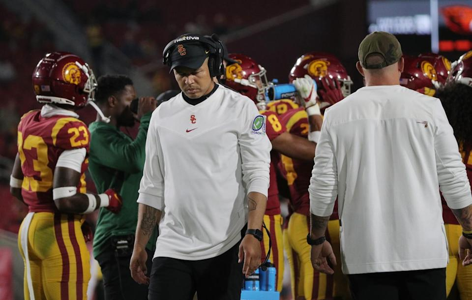 USC Trojans interim coach Donte Williams walks the sideline during the closing moments of a loss to Oregon State