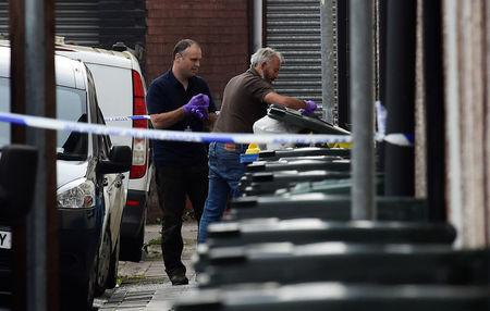 Investigators search rubbish bins behind a police cordon after three men were arrested in connection with an explosion on the London Underground, in Newport, Wales, Britain, September 20, 2017. REUTERS/Rebecca Naden