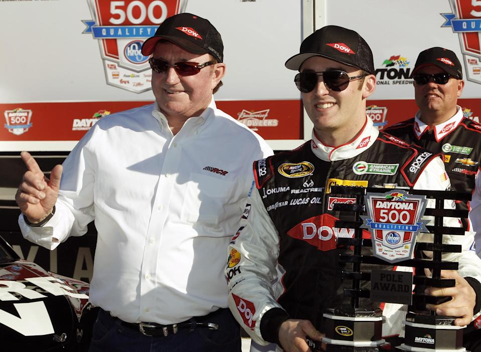 Austin Dillon, right, holds up the pole award with car owner and grandfather Richard Childress after qualifying for the pole position in the Daytona 500 NASCAR Sprint Cup Series auto race at Daytona International Speedway in Daytona Beach, Fla., Sunday, Feb. 16, 2014. (AP Photo/Terry Renna)