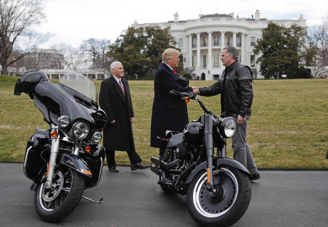 President Donald Trump and Vice President Mike Pence greet Harley Davidson President and CEO Matthew S. Levatich on the South Lawn of the White House in Washington in 2017. (AP Photo/Pablo Martinez Monsivais)