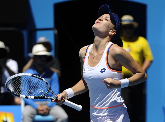 Agnieszka Radwanska of Poland celebrates after defeating Victoria Azarenka of Belarus during their quarterfinal at the Australian Open tennis championship in Melbourne, Australia, Wednesday, Jan. 22, 2014.(AP Photo/Andrew Brownbill)
