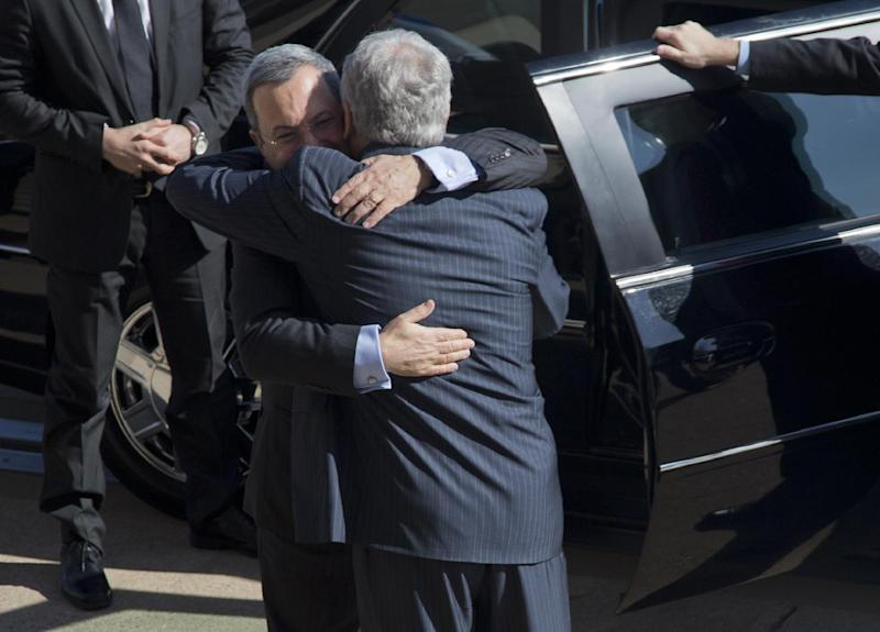 Defense Secretary Chuck Hagel , right, embraces Israeli Defense Minister Ehud Barak as he arrives at the Pentagon for an honor cordon, Tuesday, March 5, 2013. (AP Photo/Carolyn Kaster)
