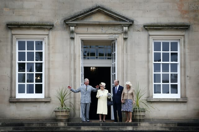 The Queen, Duke of Edinburgh and Charles and Camilla at Dumfries House, which is due to reopen to the public next week. Danny Lawson/PA Wire