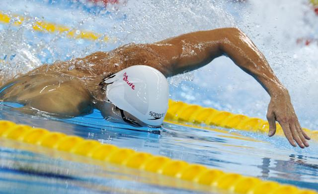 US swimmer Nathan Adrian competes in the heats of the men's 100-metre freestyle swimming event in the FINA World Championships at the indoor stadium of the Oriental Sports Center in Shanghai on July 27, 2011. AFP PHOTO / MARK RALSTON (Photo credit should read MARK RALSTON/AFP/Getty Images)