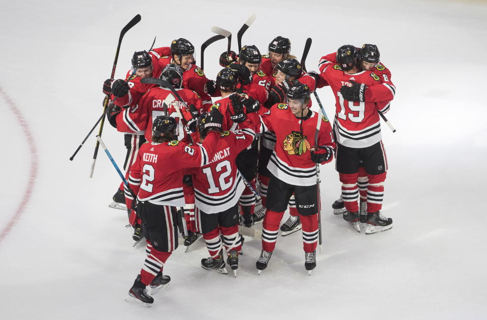 Chicago Blackhawks players celebrate their win over the Edmonton Oilers in an NHL hockey playoff game Friday, Aug. 7, 2020, in Edmonton, Alberta. (Jason Franson/Canadian Press via AP)