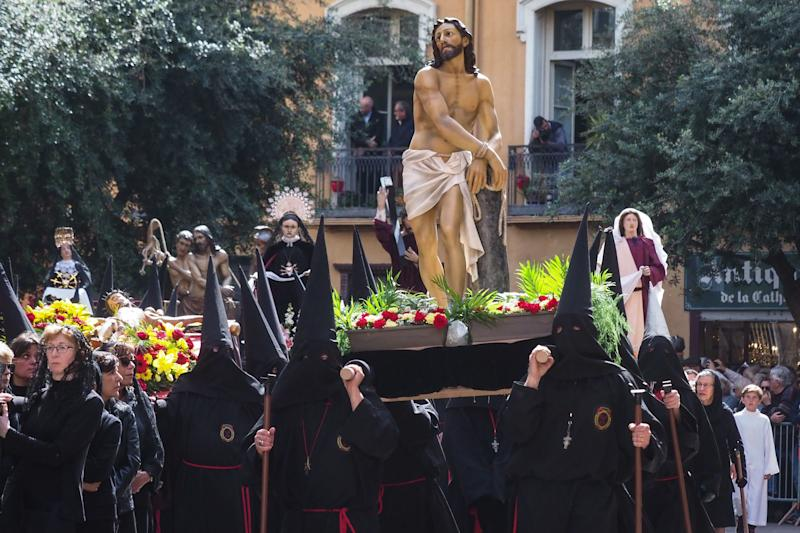 A group of penitents takes part in a traditional Catalan Good Friday procession in the center of Perpignan, southwestern France, on April 19, 2019.  (RAYMOND ROIG via Getty Images)