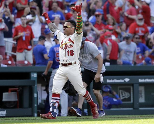 Cardinals' infielder Kolten Wong celebrates his walk-off two-run home run during the 10th inning of Saturday's game against the Cubs. (AP)