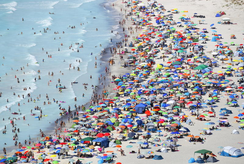 An aerial view taken from the HH412C helicopter 'Volpe 220' of the Pisa Air Section of the Guardia di Finanza of vacationers on the so-called 'White Beaches', in Rosignano Solvay, Tuscany region.Source: EPA