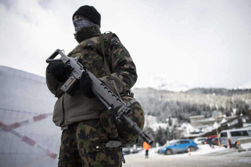 A soldier of the Swiss Army is on guard outside the congress center prior the 50th annual meeting of the World Economic Forum, WEF, in Davos, Switzerland, Sunday, Jan. 19, 2020. (Gian Ehrenzeller/Keystone via AP)