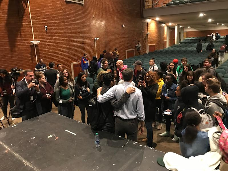 Democratic presidential candidate Beto O'Rourke poses for selfies with high school students after an assembly Friday morning at North High School in Des Moines.