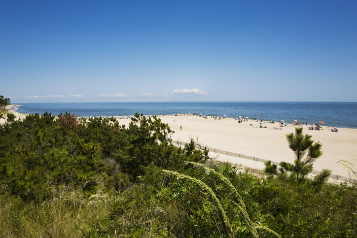 "<p>With its gentle dunes and stunning views of the historic Henlopen lighthouse, this <a href=""https://destateparks.com/Beaches/CapeHenlopen"" rel=""nofollow noopener"" target=""_blank"" data-ylk=""slk:six-mile stretch of protected shoreline"" class=""link rapid-noclick-resp"">six-mile stretch of protected shoreline</a> is a rich escape from the developed bustle of other Delaware beaches. It's a haven for lovers of swimming, bird watching, fishing, boating, paddle-boarding, and windsurfing. </p>"
