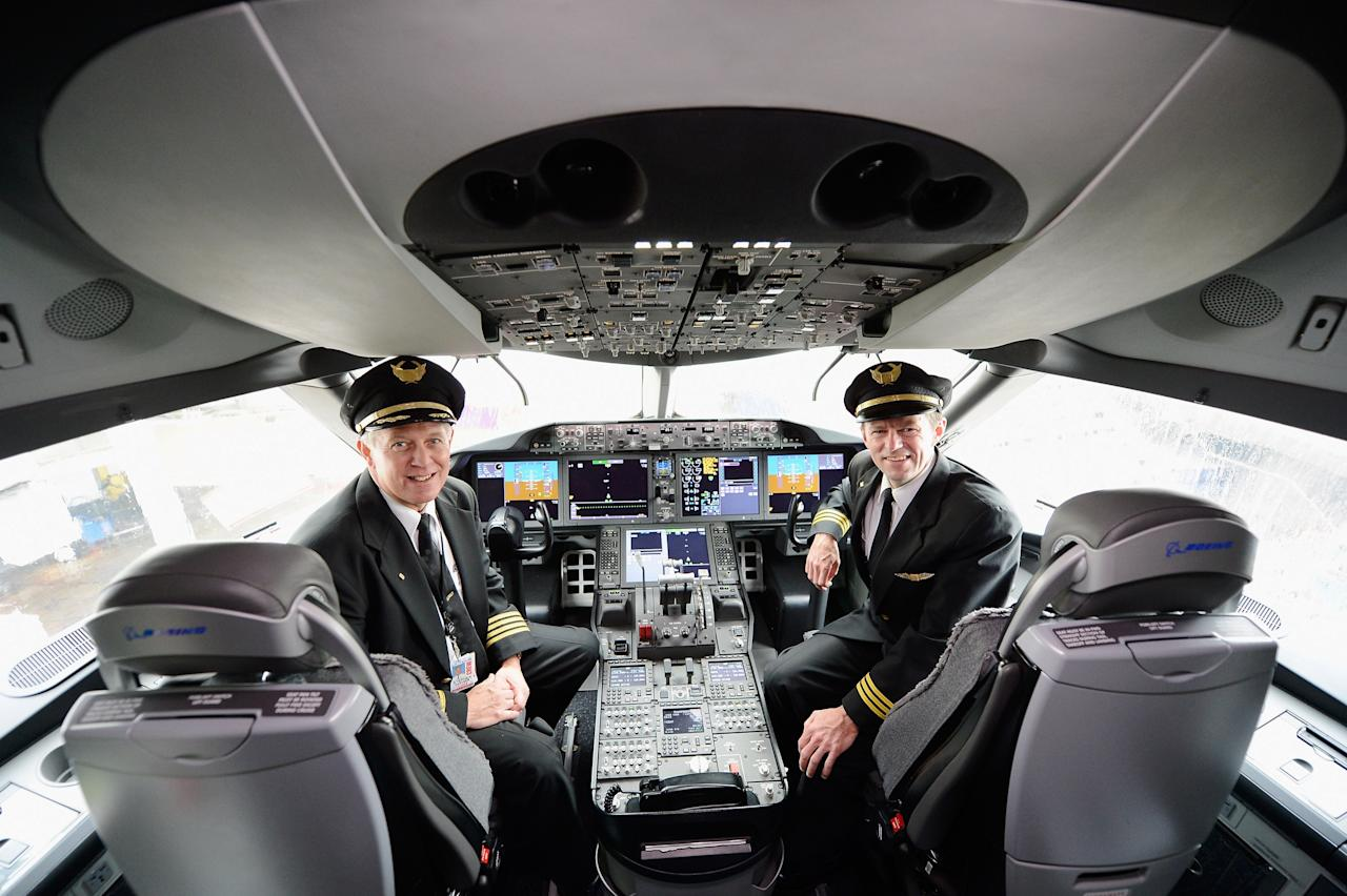 LOS ANGELES, CA - NOVEMBER 30:  United Airlines Captain Stephen Kastner (L) and First officer Mike McCann sit in the cockpit of the new Boeing 787 Dreamliner at Los Angeles International Airport on November 30, 2012 in Los Angeles, California.  In January the new jet is scheduled to begin flying daily non-stop between Los Angeles International airport and Japan's Narita International Airport and later to Shanghai staring in March. The new Boeing 787 Dreamliner will accomodate 219 travelers with 36 seats in United Business First, 70 seats in Economy Plus and 113 in  Economy Class. The carbon-fiber composite material that makes up more than 50 percent of the 787 makes the plane more fuel-efficient.  (Photo by Kevork Djansezian/Getty Images)