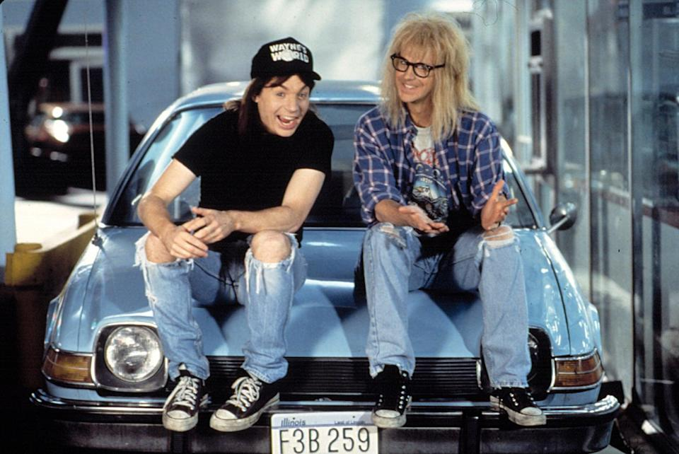 """<ul> <li><b>What to wear for Wayne:</b> Black Converse sneakers, old, ripped jeans, a long brown wig, a black t-shirt, and a black <b>Wayne's World</b> hat.</li> <li><b>What to wear for Garth:</b> Black Converse sneakers, washed-out jeans, a white band t-shirt under a blue plaid shirt with rolled-up sleeves, a shaggy blond wig, and black-rimmed glasses.</li> <li><b>How to act:</b> Ask people if they want to come to your basement and be a guest star on your show. At some point you're going to have to sing """"Bohemian Rhapsody.""""</li> </ul>"""
