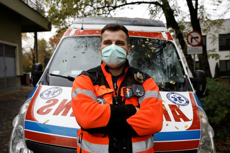 Paramedic Marcin Serwach, 35, attends an interview with Reuters amid the global outbreak of the coronavirus disease (COVID-19), at a cemetery in Warsaw