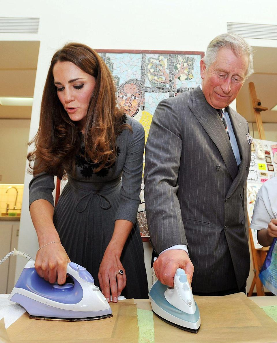 <p>Kate Middleton and Prince Charles show off their ironing skills while participating in an art project at the Dulwich Picture Gallery. </p>