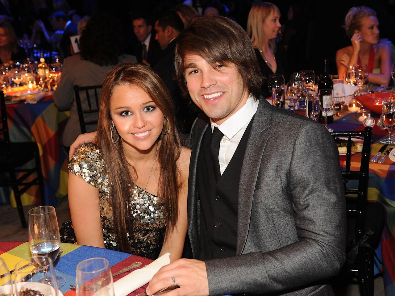 "<p>When Miley was 15, she struck up a relationship with Justin, who was 20 at the time, after he competed on her dad Billy Ray Cyrus's reality show <strong>Nashville Star</strong>. While it's unclear what led to their split (<a href=""http://www.mtv.com/news/1613544/miley-cyrus-and-justin-gaston-have-split-up-sources-say/"" target=""_blank"" class=""ga-track"" data-ga-category=""Related"" data-ga-label=""http://www.mtv.com/news/1613544/miley-cyrus-and-justin-gaston-have-split-up-sources-say/"" data-ga-action=""In-Line Links"">some say her rekindled friendship with Nick Jonas was to blame</a>), they called it quits nine months later in 2009 when Miley left to film <strong>The Last Song</strong> in Savannah, GA. </p>"