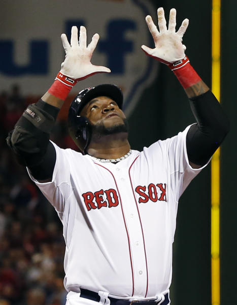 Boston Red Sox designated hitter David Ortiz raises his hands while crossing the plate with a two-run home run in the first inning of a baseball game against the Baltimore Orioles at Fenway Park in Boston, Wednesday, Sept. 18, 2013. (AP Photo/Elise Amendola)
