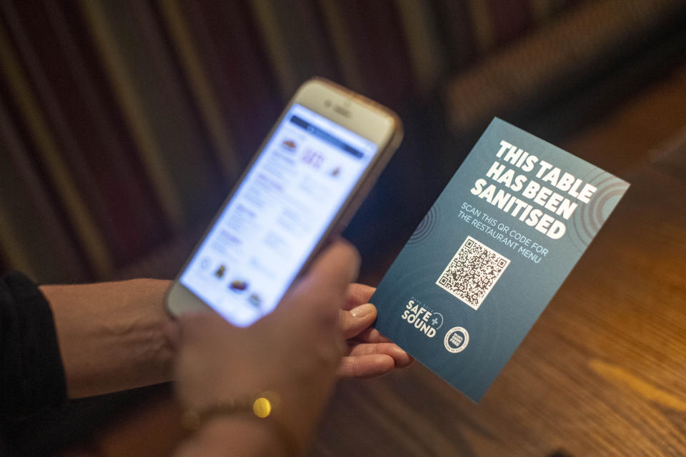 A QR code opens a digital restaurant menu to replace a hard copy on a table at the Hard Rock Cafe's European flagship restaurant in Piccadilly Circus, London, as it prepares to reopen to members of the public when the lifting of further lockdown restrictions in England comes into effect on Saturday. (Photo by Victoria Jones/PA Images via Getty Images)
