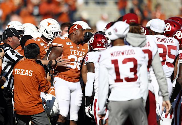 Both Texas and Oklahoma got flagged ahead of their big rivalry game. (Photo by Ronald Martinez/Getty Images)