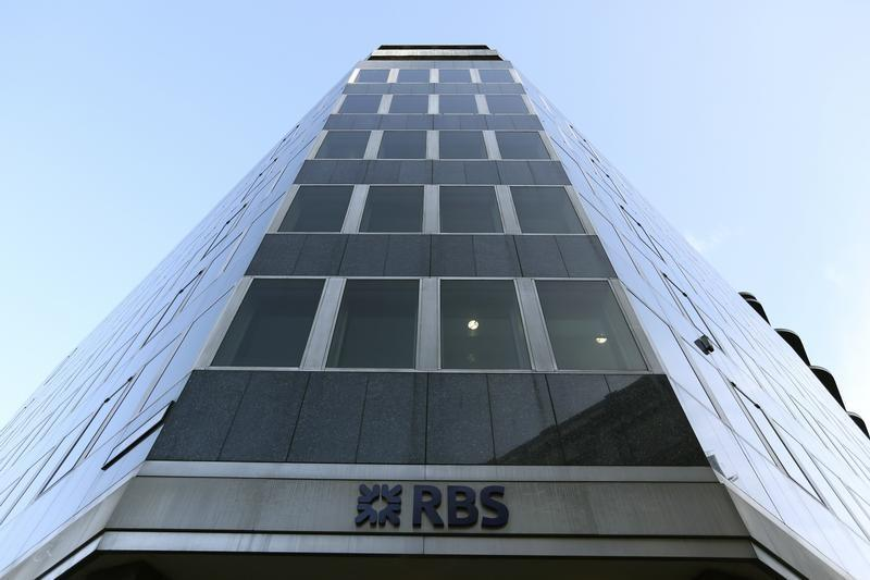 A sign is seen outside a Royal Bank of Scotland building in central London