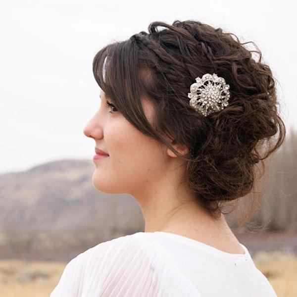 """<div class=""""caption-credit""""> Photo by: Etsy seller MelindaRoseDesign</div><div class=""""caption-title"""">4. Jeweled Clip</div><a rel=""""nofollow noopener"""" href=""""http://www.etsy.com/listing/101436860/silver-rhinestone-bridal-comb-crystal?ref=sr_gallery_31&ga_search_query=bridal+rhinestone+hair+comb&ga_view_type=gallery&ga_ship_to=ZZ&ga_min=0&ga_max=0&ga_page=6&ga_search_type=all"""" target=""""_blank"""" data-ylk=""""slk:Silver rhinestone bridal comb"""" class=""""link rapid-noclick-resp"""">Silver rhinestone bridal comb</a> by Etsy seller MelindaRoseDesign. <br> <br> <b>Related: <a rel=""""nofollow noopener"""" href=""""http://www.bridalguide.com/beauty-fitness/hair/best-wedding-hairstyles"""" target=""""_blank"""" data-ylk=""""slk:Best Wedding Hairstyles"""" class=""""link rapid-noclick-resp"""">Best Wedding Hairstyles</a></b>"""