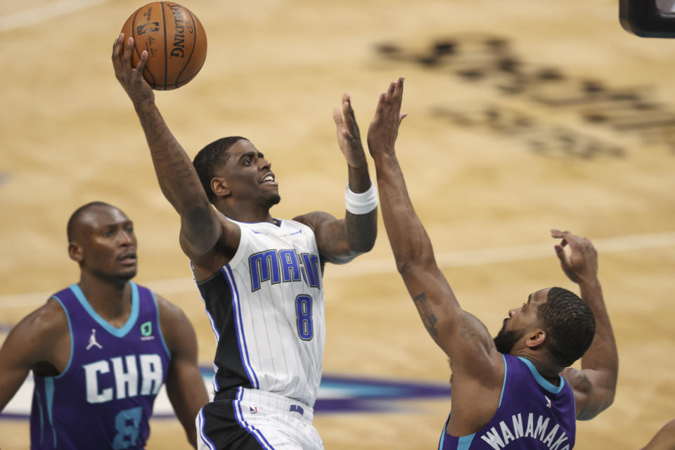 Orlando Magic guard Dwayne Bacon (8) shoots over Charlotte Hornets guard Brad Wanamaker during the second half of an NBA basketball game in Charlotte, N.C., Friday, May 7, 2021. (AP Photo/Nell Redmond)